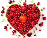 Red berries for in heart-shaped box royalty free stock images