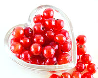 Red berries in a heart shaped container Stock Photo