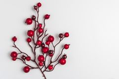 Red berries holly on white. Red Christmas ornaments frame. Image of Christmas. Top view with copy space royalty free stock photos