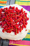 Red berries pavlova Stock Images