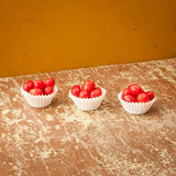 Red berries on a rustic wooden table Stock Images