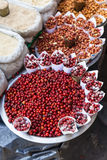 Red Berries and Stirred fire Peanuts topping with salt in paper cone at street local market in Darjeeling. India. Royalty Free Stock Images