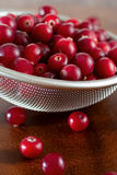 Red berries in strainer Royalty Free Stock Photography