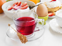 Red berries tea cup on breakfast meal background Royalty Free Stock Photos