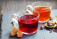 Red berries tea in transparent cups with dried flowers and fruit Royalty Free Stock Photography
