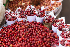 Red Berries topping with salt in paper cone at street local market in Darjeeling. India Royalty Free Stock Image