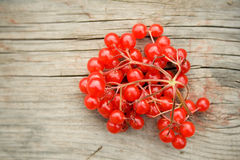 Red berries. On a wooden background Royalty Free Stock Photo