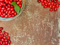 Red berries on wooden background Stock Photos