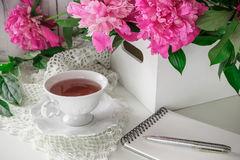 Red berry or fruit tea in teacup with peony Stock Images