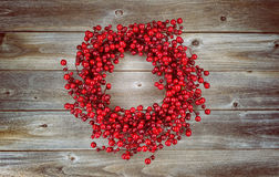 Red Berry Holiday Wreath on aged wood Stock Photos