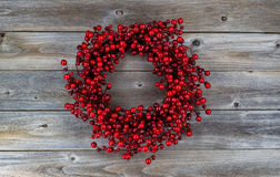 Red Berry Holiday Wreath on Wood Stock Images