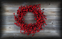 Red Berry Holiday Wreath on Wood Stock Photography