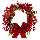 Red Berry and Pine Cone Wreath with Bow Royalty Free Stock Images