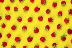 Red berry raspberries on yellow background. royalty free stock image