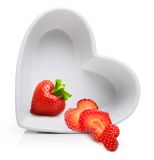 Red berry strawberry in heart shape plate Stock Images