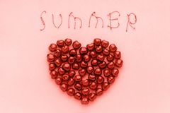 Red berry sweet cherries in shape of heart and text Summer of trendy coral shade, color of the year 2019 Template for postcard or stock photo