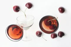 Red beverage and cherries Stock Photos