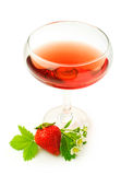 Red beverage and fresh strawberry Stock Image