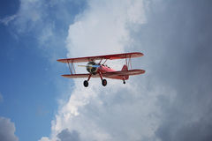 Red Bi-Plane Dramatic Sky Stock Photography