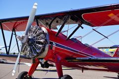 Red Bi-Plane. A red bi-plane parked at the airport royalty free stock photo
