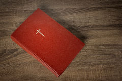 Red bible with cross on cover Stock Photography