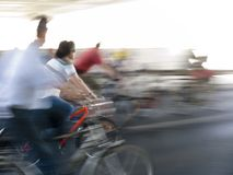 The red bicycle. Cyclists in motion in the city Stock Photography