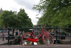 Red Bicycle on Amsterdam Bridge Over Canal stock photography