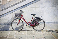 Red bicycle with basket Stock Images