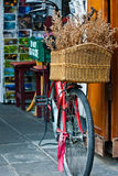Red bicycle with basket Stock Photos