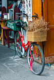 Red bicycle with basket Stock Photography