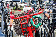 Red bicycle at a bicycle parking lot Stock Photography
