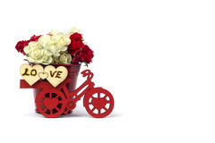 Red bicycle with a bucket of flowers & white, heart. Red bicycle with a bucket full of flowers in white background Royalty Free Stock Photo