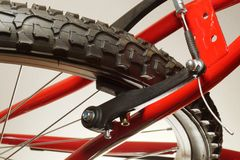 Bike, close-up on the wheel, tire. V type brakes royalty free stock image
