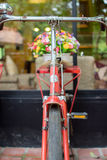 Red bicycle and colorful flowers soft focus Royalty Free Stock Photos