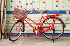 Red bicycle and colorful wood wall Stock Photos