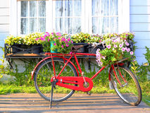 Red bicycle in front of retro white window Royalty Free Stock Images
