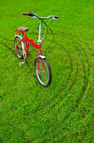 The red bicycle on grass Royalty Free Stock Photography
