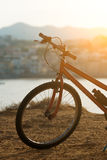 Red bicycle. Red bicycle on the hill at sunset royalty free stock images