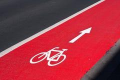 Red Bicycle lane with bike symbol stock photo