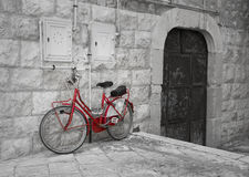 Red bicycle leaning against wall. Stock Images