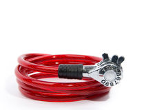 Red bicycle lock. Red numeric combination bicycle lock on isolated white background Royalty Free Stock Photos