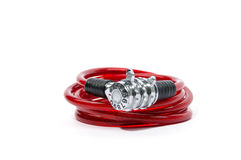 Red bicycle lock. Red numeric combination bicycle lock on isolated white background Royalty Free Stock Photo
