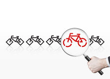 Red bicycle with magnifier Stock Images