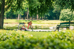 Red bicycle in park Stock Photo