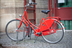 Red bicycle parked in the city Stock Photography