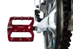 Red bicycle pedal Close-up. Isolated on a white background. royalty free stock images