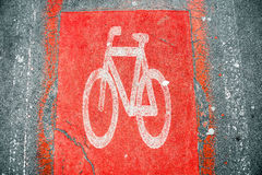 Red Bicycle road sign on the asphalt Royalty Free Stock Image