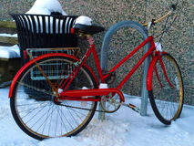 Red bicycle in the snow Stock Photo