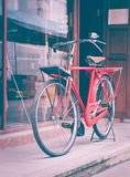 Red bicycle standing on street Royalty Free Stock Photo