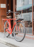 Red bicycle standing on street Stock Images